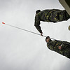 Romanian Army Soldiers prepare to remove a flag from the tether line of a Persistent Ground Surveillance System Aerostat during Unified Vision 14 Trial, outside of Brekstad, Norway, May 23, 2014. (Photo by U.S. Air Force Staff Sgt. Andrew Davis)