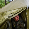 A Norwegian soldier peeks out of a tent during Unified Vision 14 Trial, May 24, 2014. (Photo by U.S. Air Force Staff Sgt. Andrew Davis)