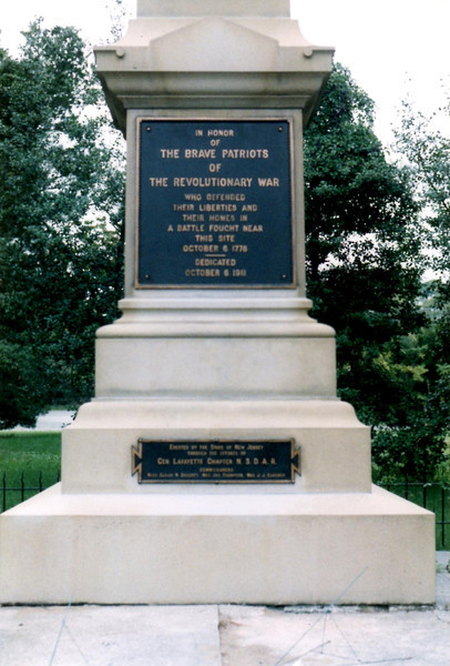 Plaque on the base of the monument