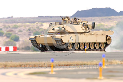 M1 Abrams 00001 A moving General Dynamics Land Systems USMC M1 Abrams main battle tank in a desert setting, defending a friendly air base, armor picture by Peter J  Mancus