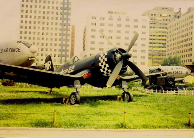 The actual last Corsair Dad flew in WWII sitting outside in dowtown Seoul Korea's American Military Museum. How cool is that!!