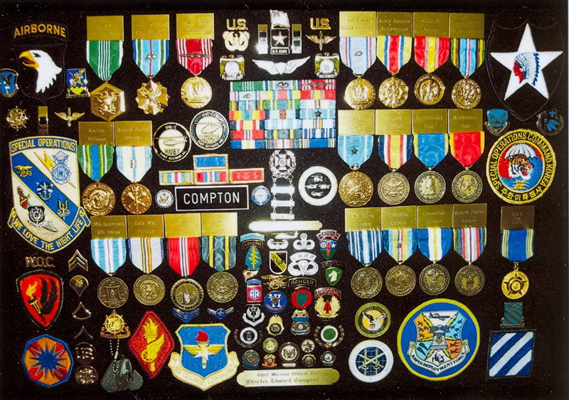 """My Wall Display Case with Commemoratives. The small pins in center are the highlight of the elite units, among many others, I was honored to """"Chauffeur"""". The best jobs I ever had with my pants on !!"""