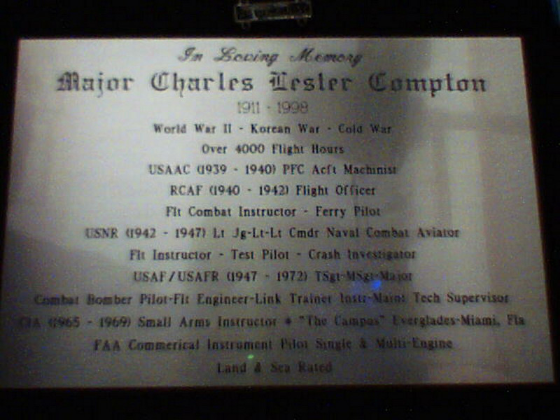 Dad's brass plaque in his main memorial display case.