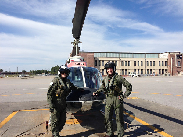 Dallas and Nick in front of their helicopter after their solo