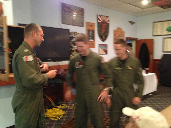 Lt. Lawson removing Nick's old patch, with the Navy crest, and replacing it with his new one with aviator wings embossed on it!