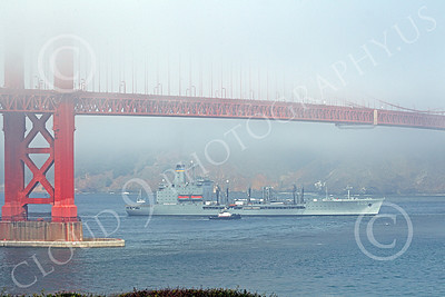 USNWS 00088 The US Navy's USS Guadalope (A0-32), A Cimarron-class fleet replenishment oiler, seen sailing under the Golden Gate Bridge from the Pacific Ocean, by Peter J Mancus
