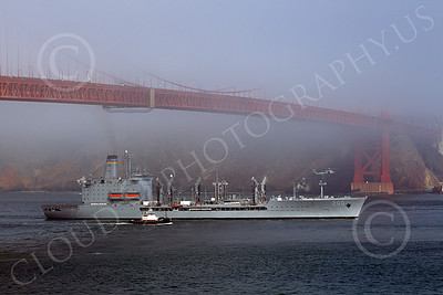 USNWS 00089 The US Navy's USS Guadalope (A0-32), A Cimarron-class fleet replenishment oiler, seen sailing under the Golden Gate Bridge from the Pacific Ocean, by Peter J Mancus