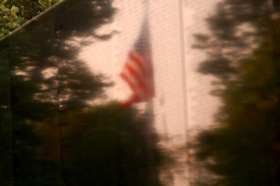 The Flag our men and women died for..reflected on the Vietnam Wall