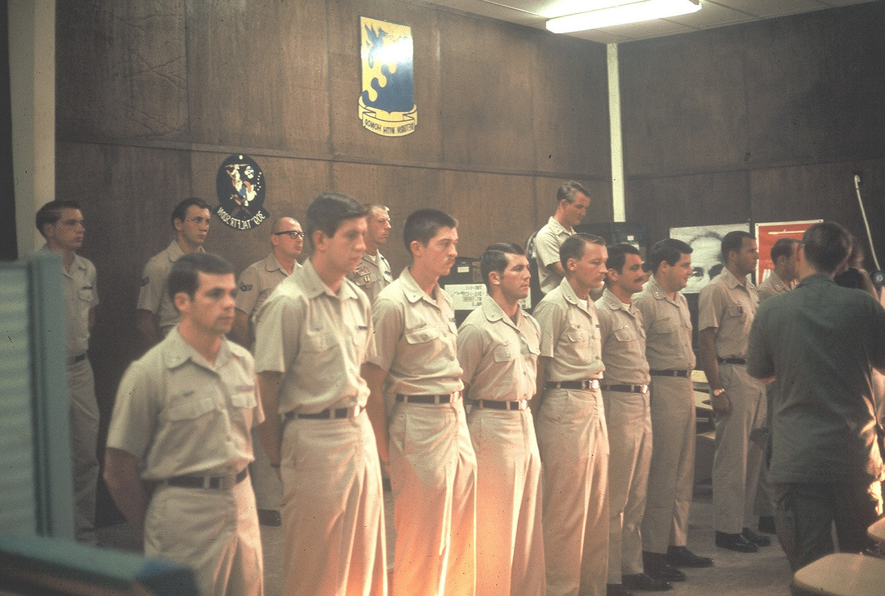 "309th TFS.. 1969 back row at podium..Art Suro to his rt Lt Col Larry Whitford (""Misty"" FAC KIA) Front row Tom Wittman, Vince Willett, Dave Ladd, Rick Goddard, ??, Lacy Veach, Rodger Welch,, ""Ram-FAC""(played piano w/ Boston Symphony)...let me know of you know any of the others..Thanks"
