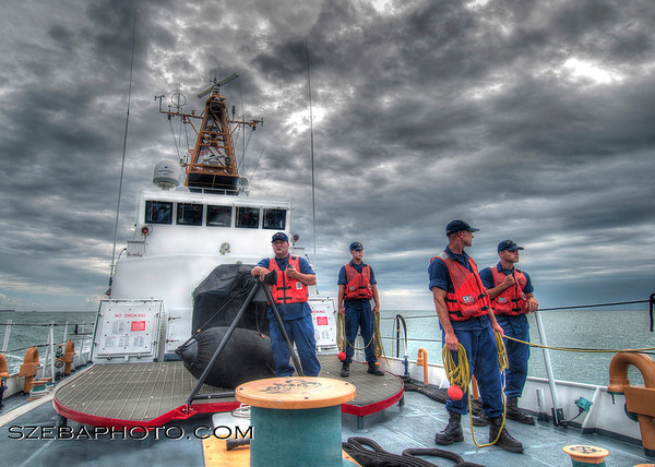 2013. Crew of a 110' Coast Guard Cutter stands ready to throw lines as the ship enters port.
