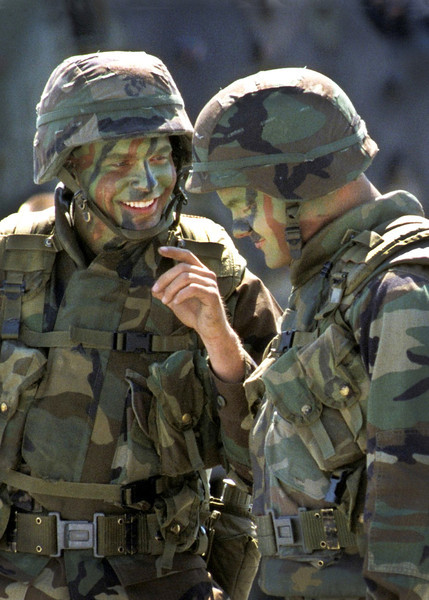 A US Marine shares a joke during a break in training. Camp Lejeune, NC. 1998.