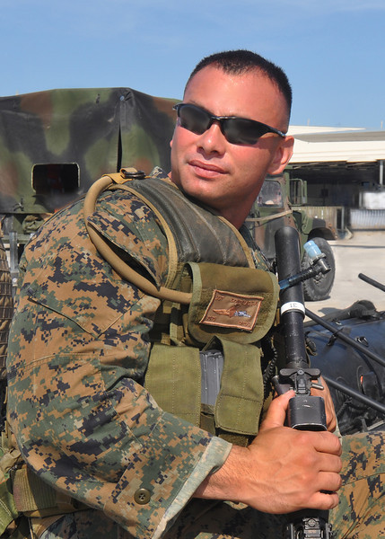 A Special Operations US Marine poses by his gear. 2012.