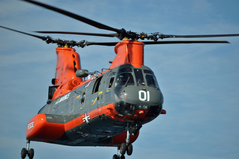CH-46 'Pedro' rescue chopper doing a low fly-by over a Coast Guard boat during exercises off Jacksonville, NC. 2010.