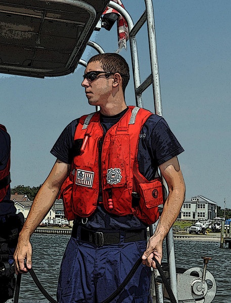 Coast Guard petty officer mans the lines of a patrol craft during training - Emerald Isle, NC. 2011