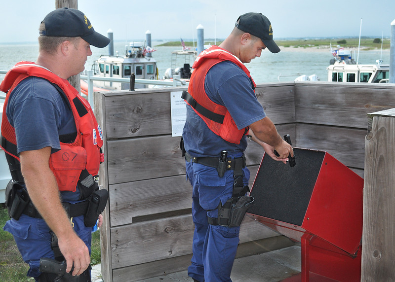 US Coast Guard personnel clear their weapons after completing a patrol. Emerald Isle, NC. 2011