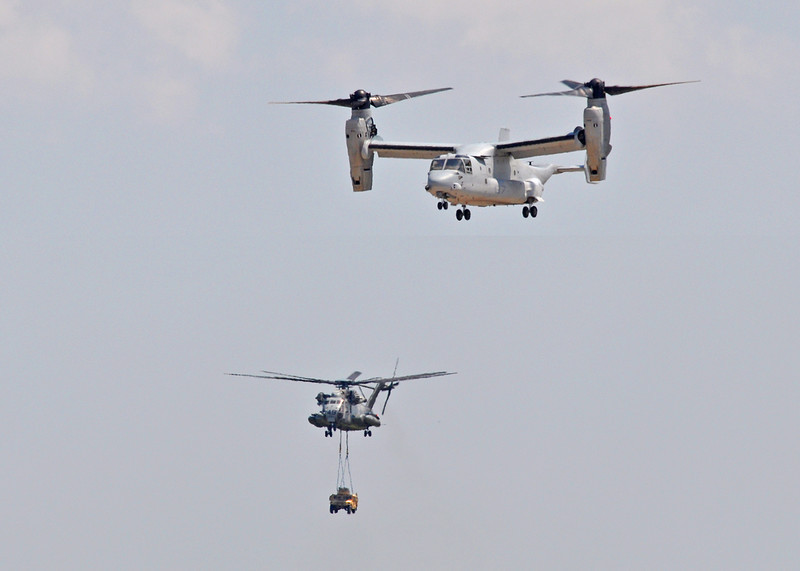 MV-22 Osprey and CH-53 carrying a vehicle head towards a landing zone. Camp Lejeune, NC. 2012.