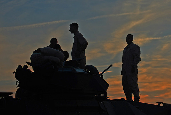 US Marines relax on top of an armoured vehicle at sunset. Camp Lejeune, NC