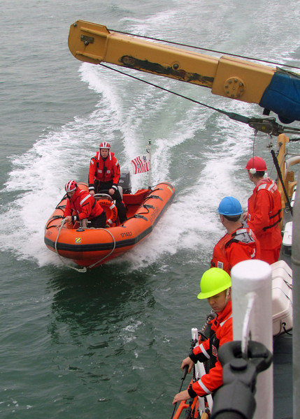 17 ft inflatable boat comes alongside USCG Cutter Block Island in preparation for hoisting aboard. 2012.