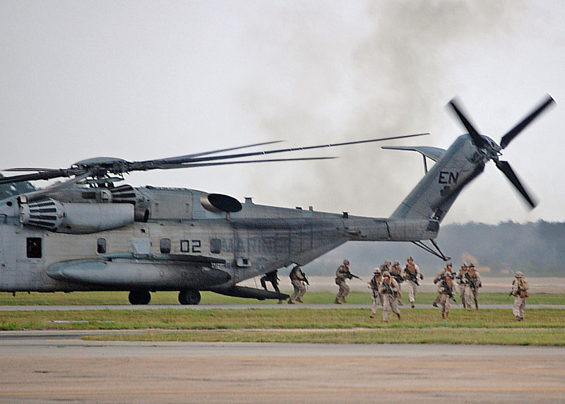 US Marines exit a CH-53 during a MAGTF firepower demonstration. MCAS New River. 2012.