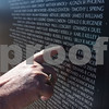 Joe Hively of Tyler points out the name of his cousin, Michael A. Randall, Sr., on the traveling Vietnam Wall at Tyler Pounds Regional Airport during Rose City Rotor Fest Saturday Oct. 22, 2016. <br /> <br /> (Sarah A. Miller/Tyler Morning Telegraph)