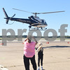 Michele Richardson and Miley Richardson, 7, of Athens, watch a helicopter take off at Tyler Pounds Regional Airport during Rose City Rotor Fest Saturday Oct. 22, 2016. <br /> <br /> (Sarah A. Miller/Tyler Morning Telegraph)