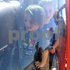 Korbyn Alexander, 3, and Kaylyn Gage, 9, of Hawkins, sit inside a TH57 helicopter at Tyler Pounds Regional Airport during Rose City Rotor Fest Saturday Oct. 22, 2016. <br /> <br /> (Sarah A. Miller/Tyler Morning Telegraph)