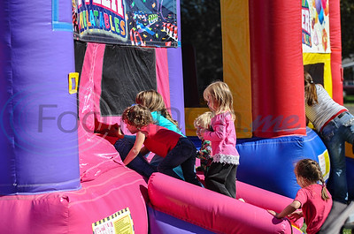 Young girls enter a bounce house at Bullard's 19th annual Red, White and Blue Festival. The event took on Saturday, November 3 and included a car show, live music, bounce houses and food vendor. (Jessica T. Payne/Tyler Morning Telegraph)