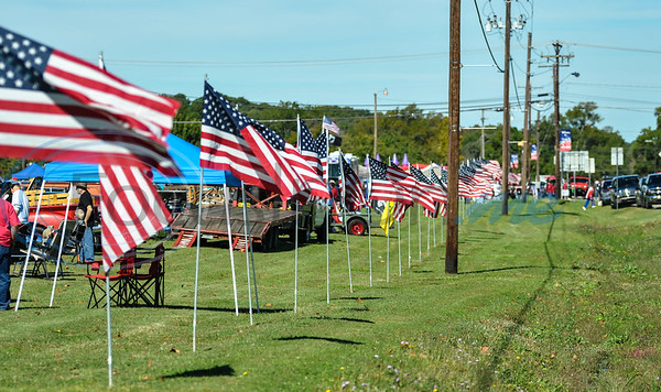 Flags line Houston Street in downtown Bullard for the 19th annual Red, White and Blue Festival on November 3. The festival recognizes and honors the sacrifices and service of veterans and active duty. (Jessica T. Payne/Tyler Morning Telegraph)