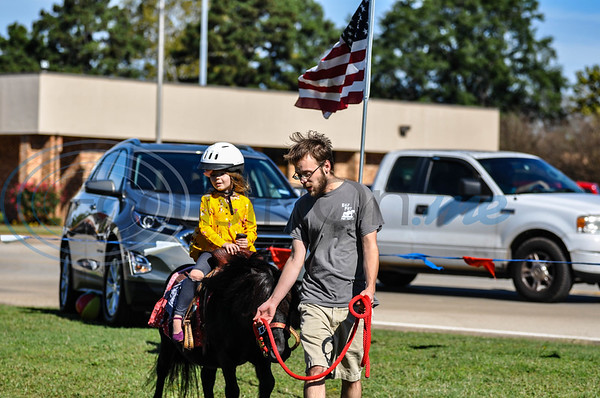 Kaydence Kimble, 5, enjoys a pony ride at the 19th annual Red, White and Blue Festival on Saturday, November 3. The festival recognizes and honors the sacrifices and service of veterans and active duty. (Jessica T. Payne/Tyler Morning Telegraph)