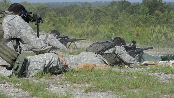 22 APR 2011 (FORT BENNING, GA) Students in week four of Sniper School, fire M107 .50 caliber long range sniper rifles. Coolidge Range, Harmony Church. Video by Joe Lynch - susanna.lynch@us.army.mil