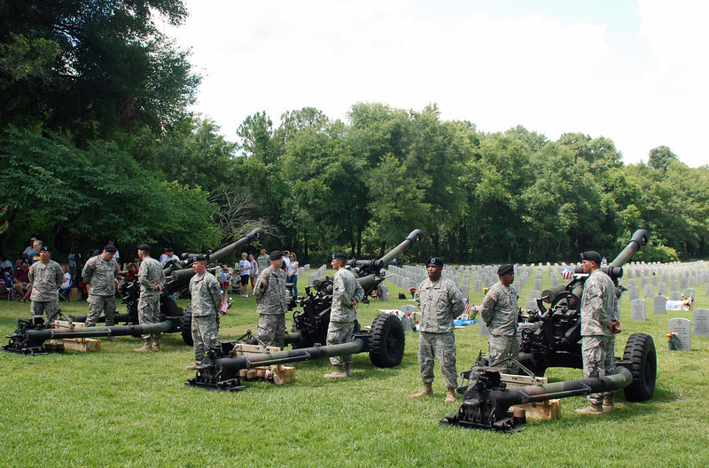 Members of 2nd Battalion, 116th Field Artillery Regiment, Winter Haven, FL. stand ready to carry out the Gun Salute.