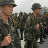 060817-N-9851B-003 Subic Bay, Philippines (Aug. 17, 2006) - Philippine Marines muster on the flight deck of amphibious dock landing ship USS Tortuga (LSD 46) in preparation for an amphibious landing as part of the Philippines phase of  exercise Cooperation Afloat Readiness and Training (CARAT). CARAT is an annual series of bilateral maritime training exercises between the United States and six Southeast Asia nations designed to build relationships and enhance the operational readiness of the participating forces. U.S. Navy photo by Mass Communication Specialist 2nd Class John L. Beeman (RELEASED)