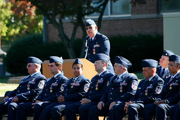 Wing Chaplain Lt Col Dave Baratelli, with other retirees looking on, addresses the Wing