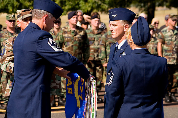 The 327th Airlift Squadron guidon is encased; 2