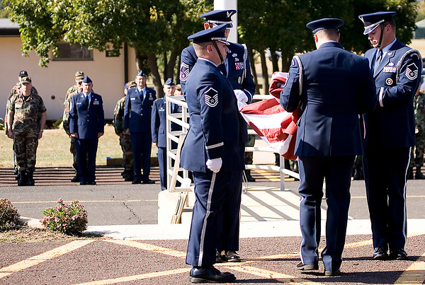 The 913th Airlift Wing Base Honor Guard lowers and folds the US Flag during the Wing's final retreat ceremony; 4.
