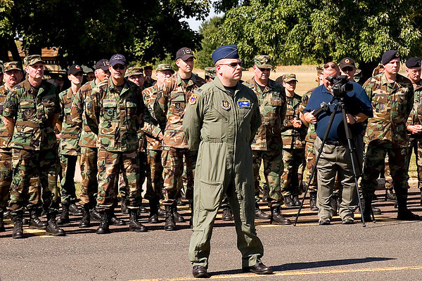 Colonel Jon Love leads a formation of 913th Airlift Wing troops.