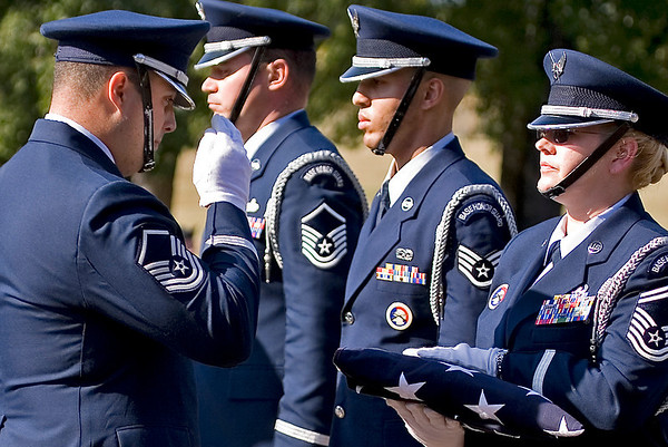 The 913th Airlift Wing Base Honor Guard lowers and folds the US Flag during the Wing's final retreat ceremony; 9.