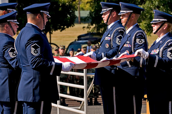 The 913th Airlift Wing Base Honor Guard lowers and folds the US Flag during the Wing's final retreat ceremony; 7.