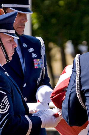 The 913th Airlift Wing Base Honor Guard lowers and folds the US Flag during the Wing's final retreat ceremony; 5.