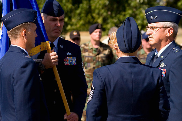 913th Airlift Wing Command Chief Master Sergeant Clifford B. Van Yahres presents the Wing Colors to 913th Airlift Wing Commander Colonel Jody McMullen (on left);  Major General Martin Mazick, 22nd Air Force Commander, is on the right.