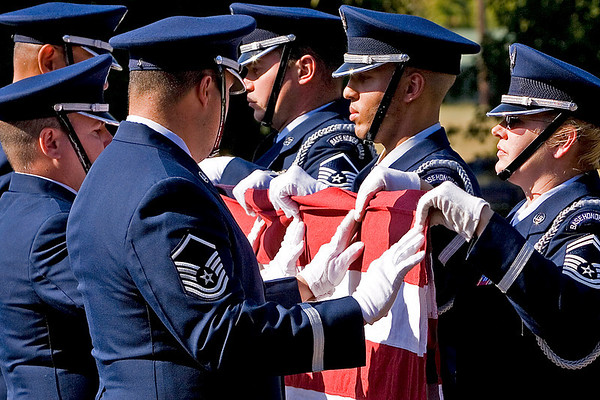 The 913th Airlift Wing Base Honor Guard lowers and folds the US Flag during the Wing's final retreat ceremony; 6.