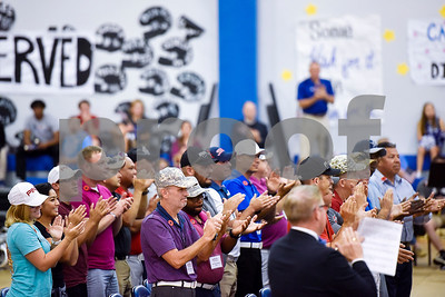 Wounded Warrior participants stand and clap after a song during a program honoring Wounded Warriors at All Saints Episcopal School in Tyler, Texas, on Friday, Sept. 29, 2017. Students and faculty dressed in red white and blue, waved American flags and sang patriotic tunes to honor the Wounded Warriors. (Chelsea Purgahn/Tyler Morning Telegraph)