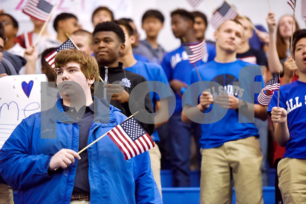 Students wave American flags during a program honoring Wounded Warriors at All Saints Episcopal School in Tyler, Texas, on Friday, Sept. 29, 2017. Students and faculty dressed in red white and blue, waved American flags and sang patriotic tunes to honor the Wounded Warriors. (Chelsea Purgahn/Tyler Morning Telegraph)