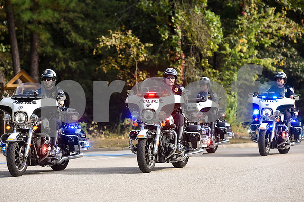 A police motorcade during a program honoring Wounded Warriors at All Saints Episcopal School in Tyler, Texas, on Friday, Sept. 29, 2017. Students and faculty dressed in red white and blue, waved American flags and sang patriotic tunes to honor the Wounded Warriors. (Chelsea Purgahn/Tyler Morning Telegraph)