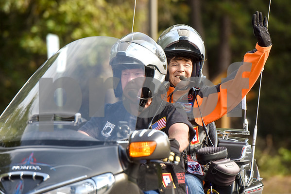 Two motorcyclists that are part of a motorcade during a program honoring Wounded Warriors at All Saints Episcopal School in Tyler, Texas, on Friday, Sept. 29, 2017. Students and faculty dressed in red white and blue, waved American flags and sang patriotic tunes to honor the Wounded Warriors. (Chelsea Purgahn/Tyler Morning Telegraph)