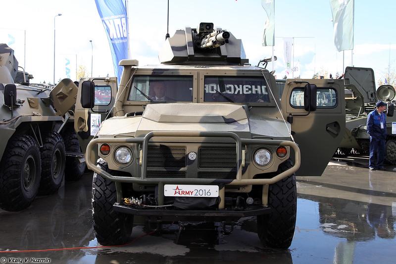 Опытный образец специального роботизированного автомобиля с дистанционно управляемым боевым модулем с 30-мм автоматической пушкой на базе АCН 233115 Тигр-М СПН (Prototype of armored unmanned ground vehicle with 30-mm remote weapon station based on ASN 233115 Tigr-M SPN armored vehicle)