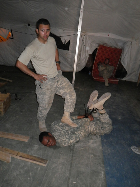 One of the LTs was preparing to leave us for another base. He was shown the proper respect [see man on floor].