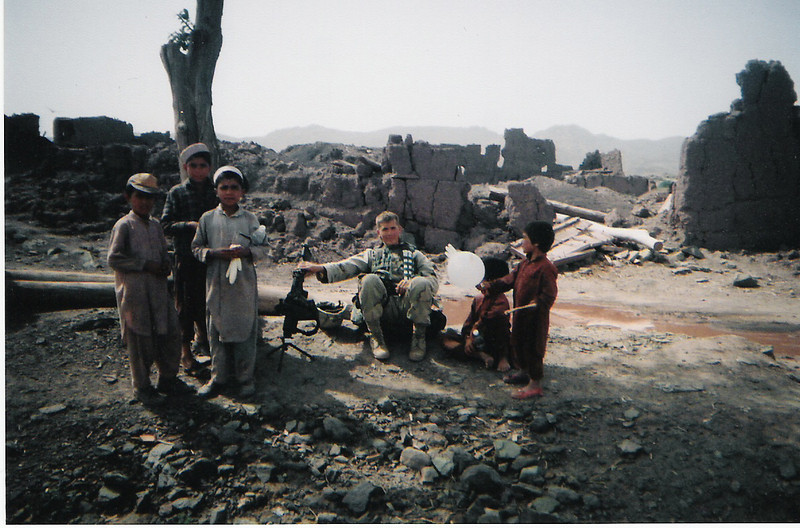 2003 - Village bombed during the initial invasion of Afghanistan. The kids love balloons (and inflated latex gloves).