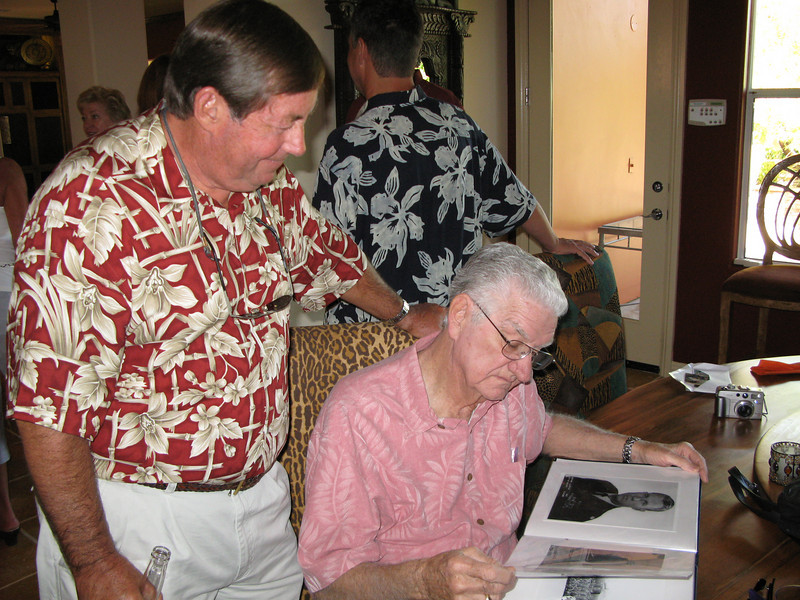 Rich and Smitty look over Boots' memory book