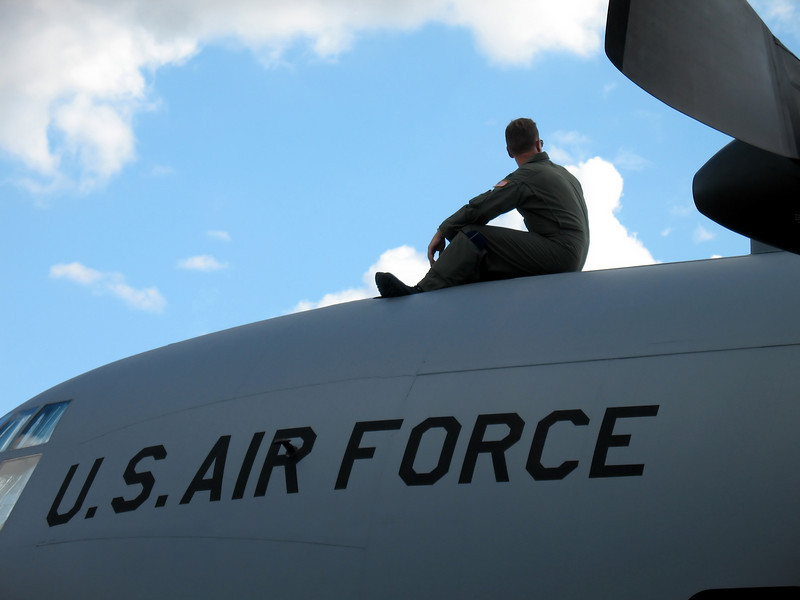 airman on top of plane